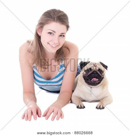 Young Beautiful Woman Lying With Pug Dog Isolated On White