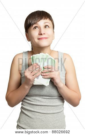 Portrait of young happy woman with money in hand.