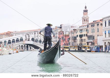 Venice - April 04: Gondoliero sailing in Venice, April 23, 2012, Venice, Italy. Grand Channel located in Venice - city on Italian islands and is famous for its gondola drivers coordinated by Guild