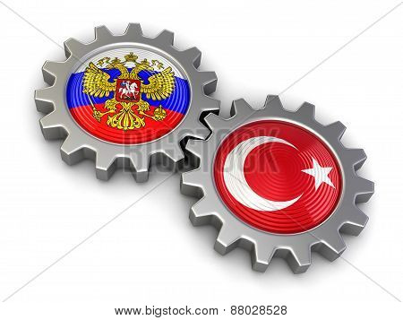 Russian and Turkish flags on a gears (clipping path included)