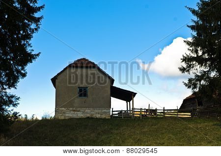 House on a hill at autumn sunny day, Radocelo mountain