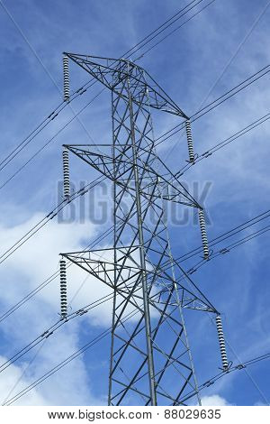 Top view of a transmission tower with high voltage power lines insulators and conductors
