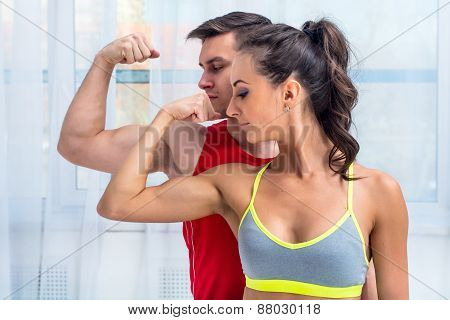 Active athletic sportive woman girl and man showing their muscles biceps healthy lifestyle