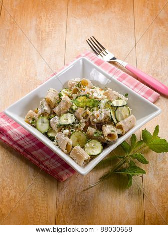 pasta with feta cheese zucchinis and mint leaf