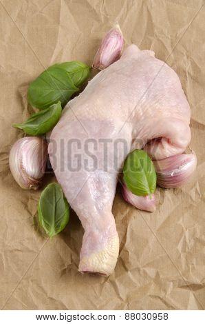 Chicken Leg With Basil And Garlic On Brown Kitchen Paper