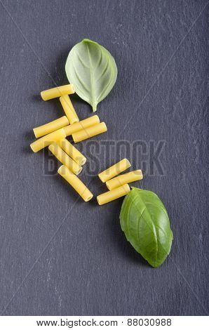 Macaroni And Basil Leaf On Slate