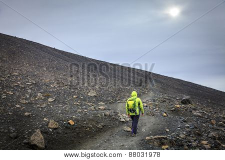Woman is taking a trail to the top of the Hverfjall crater in Northern Iceland