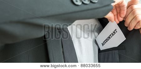 Removing Or Placing A White Card With Word Accountant In The Inner Pocket Of Suit Jacket