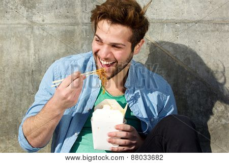 Happy Man Eating Food With Chopsticks