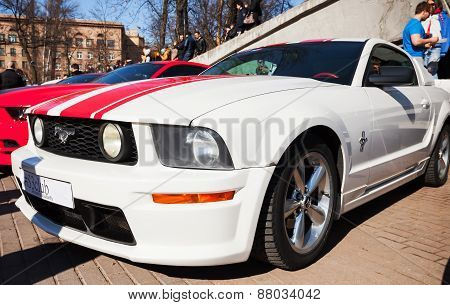 White Ford Mustang With Red Stripes Stands Parked