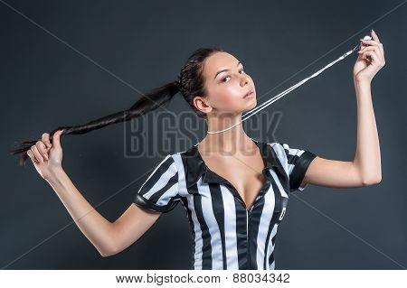 Attractive Soccer Referee holding whistle