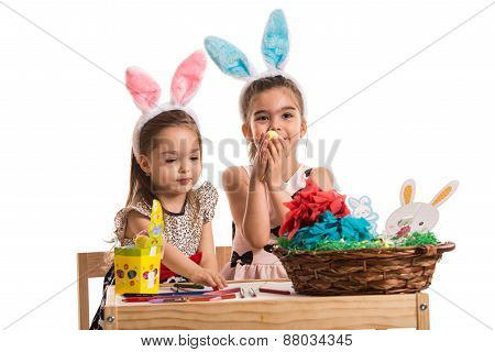 Two Girls In Kindergarten Paint Easter Eggs