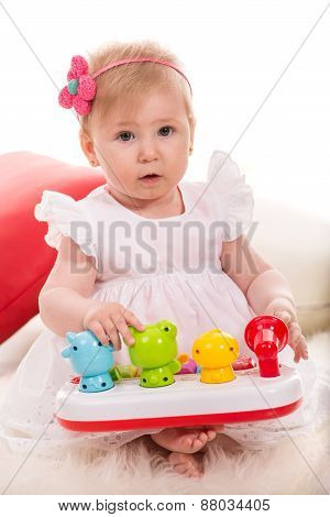 Beauty Baby Girl Playing With Toys