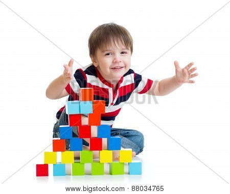 pleased kid playing toy blocks isolated