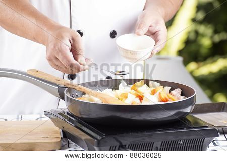 Chef Putting Seasoning Sauce To The Pan For Cooking Japanese Pork Curry