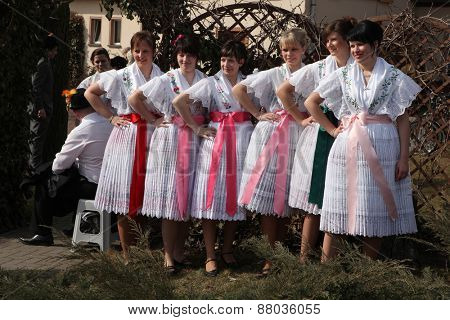 TURNOW, GERMANY - MARCH 13, 2011: Young women in Sorbian costumes attend the Zapust Carnival in the Lusatian village of Turnow near Cottbus, Lower Lusatia, Brandenburg, Germany.