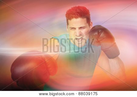 Determined male boxer focused on his training against sunrise sky