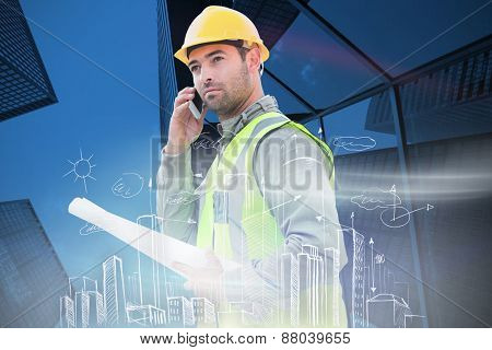 Architect on the phone against skyscraper