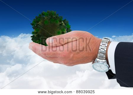 Businessman in suit offering handshake against bright blue sky over clouds