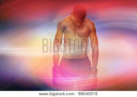 Muscular boxer against purple sky