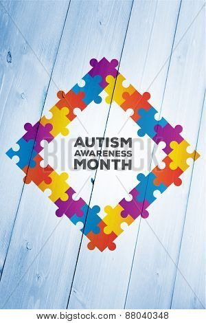 Autism awareness month against bleached wooden planks background