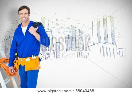 Happy electrician with wires over white background against grey