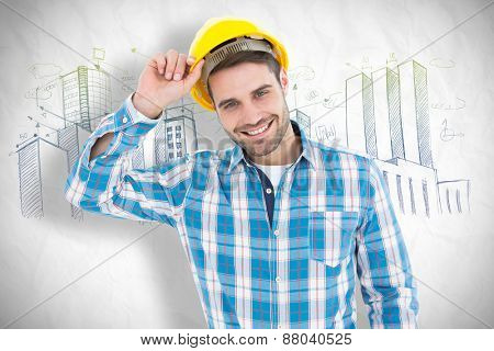 Confident male technicial wearing hard hat against crumpled white page