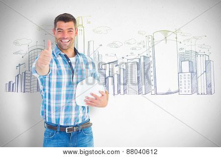 Confident manual worker gesturing thumbs up against grey
