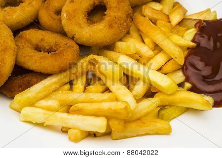 Fried Onion Rings And Potatoes With Ketchup