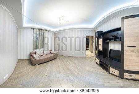 Spacious room with furniture, large closet and TV.