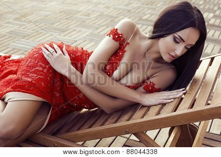 Sensual Woman With Dark Hair In Luxurious Lace Red Dress