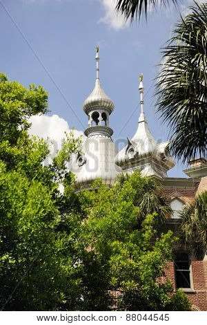 Two silver minarets as seen above the tree tops at the University of Tampa, FL.