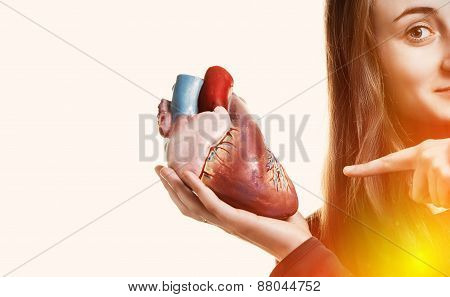 Young Woman With Heart In Hand
