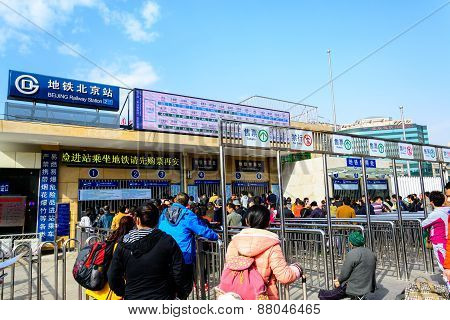Beijing, China - Mar 23, 2015 : Passangers Crowd Buying Ticket Of Subway Train