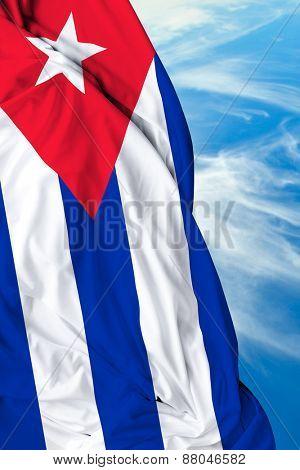 Cuban waving flag on a beautiful day
