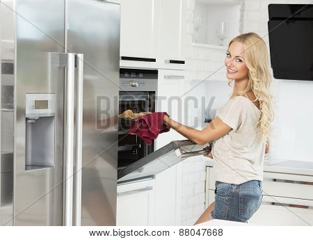 Pretty Smiling Woman Near Oven