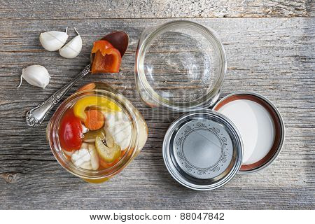 Home preserving mixed vegetables by pickling in glass canning jars