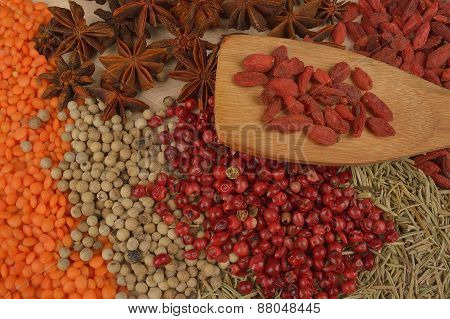 Different Spices On Wooden Background. Close Up