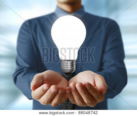idea concept, man holding light bulb