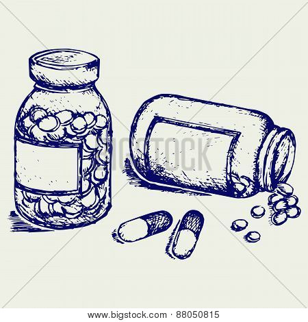 Pill bottle. Spilling pills on to surfac