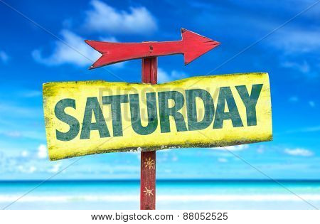 Saturday sign with beach background