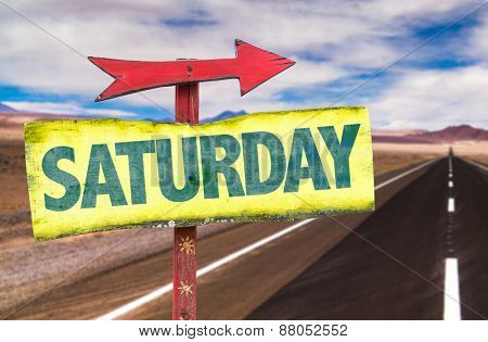 Saturday sign with road background
