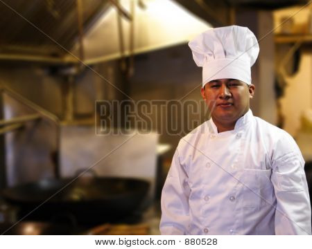 Chef Standing In Kitchen