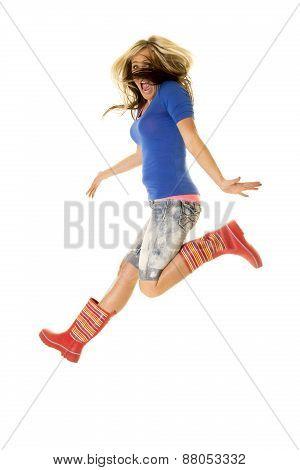 Woman Jump Body In Rain Boots Hair In Face