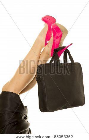 Woman Legs In Pink Heels With Black Bag On Heel