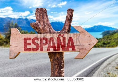 Spain (in Spanish) wooden sign with road background