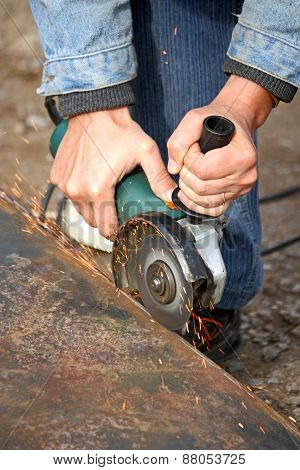 A Grinding Wheel Cuts A Metal