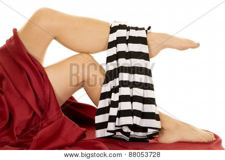 Woman Legs With Red Sheet And Prision Outfit Over Foot