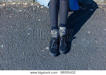 Young Woman Sitting On The Street