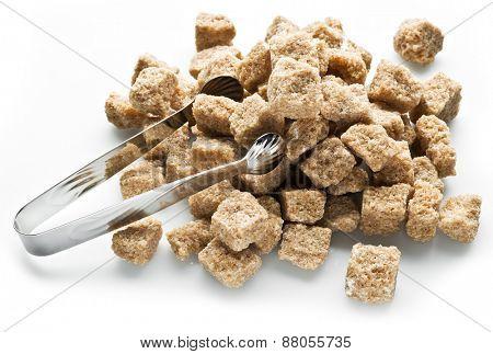 Cubes of cane sugar on white background.